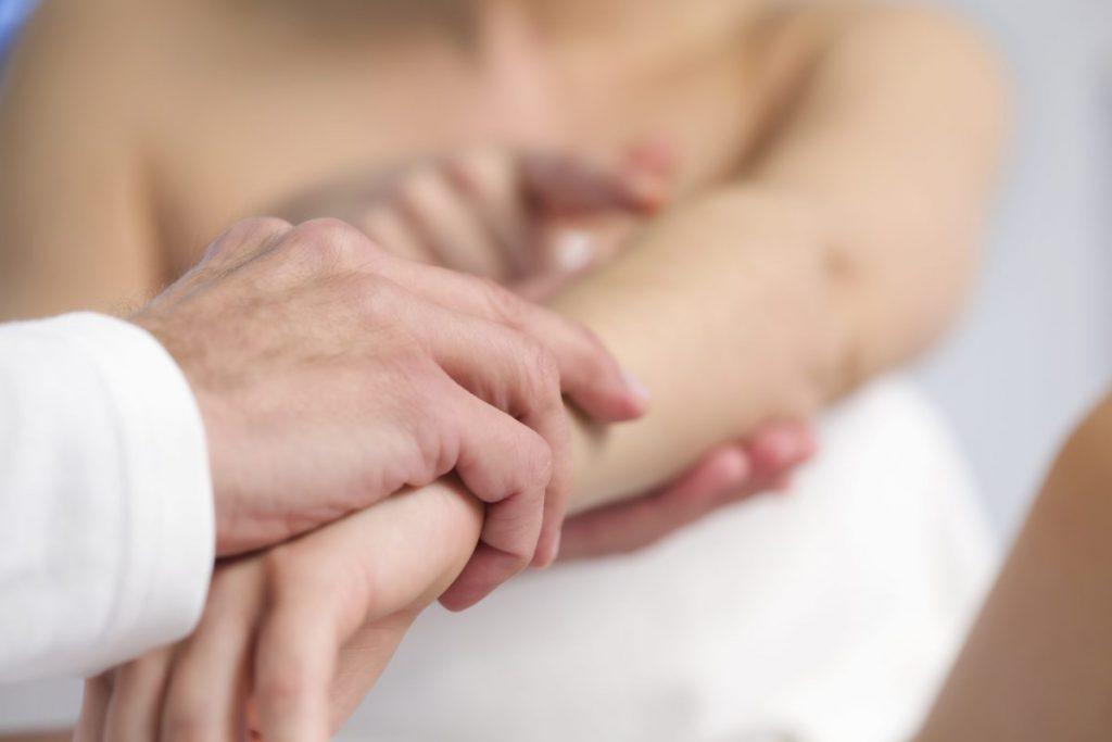 Dermatologist Examining Arm