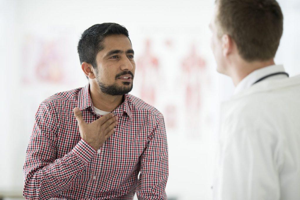 man doctor describing throat