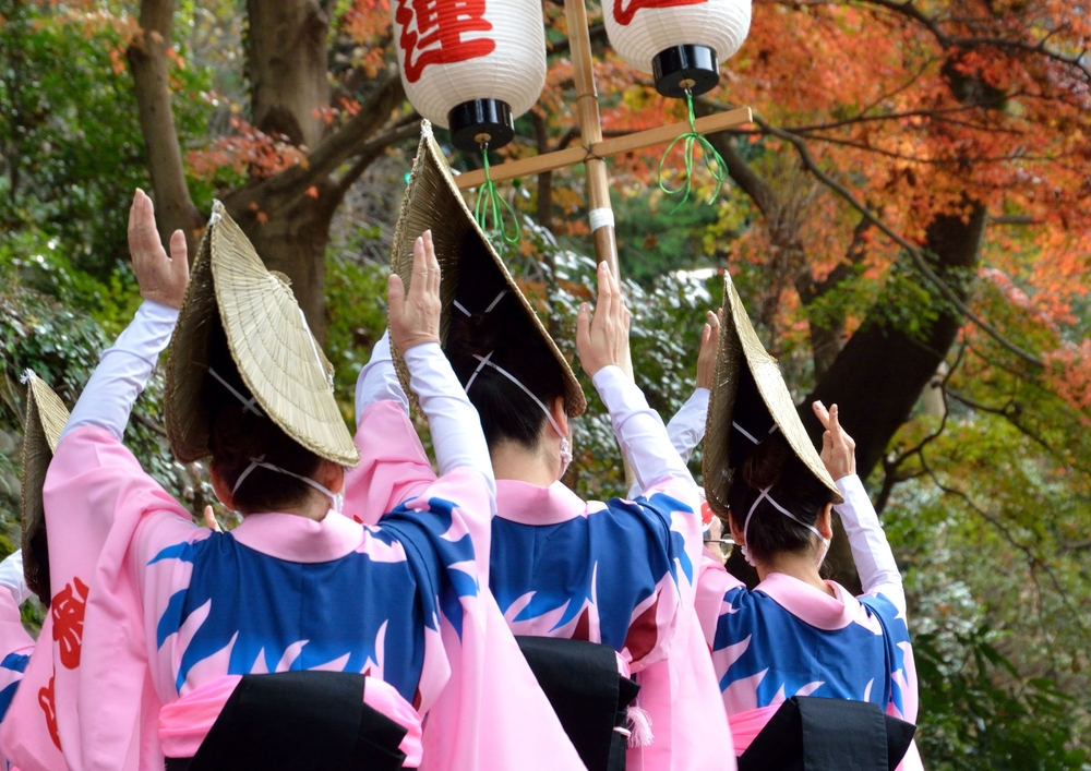 emale dancer of Awa-odori dance in japanese autumn leaves