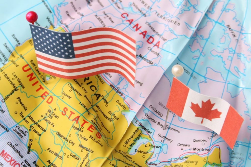 U.S./Canada map and flags