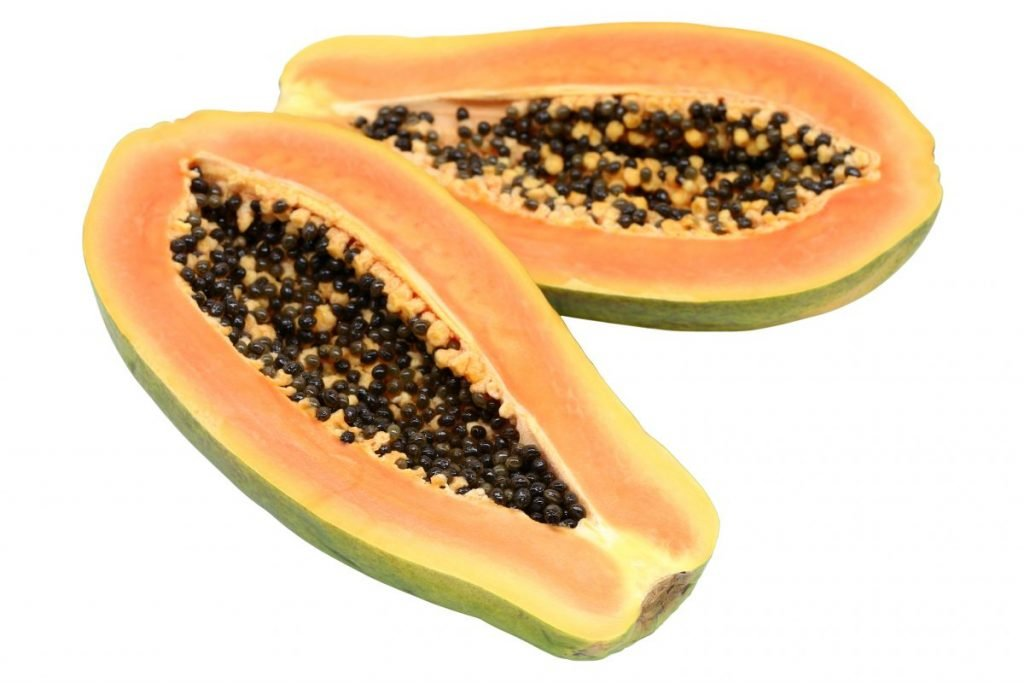 papaya cut half seeds
