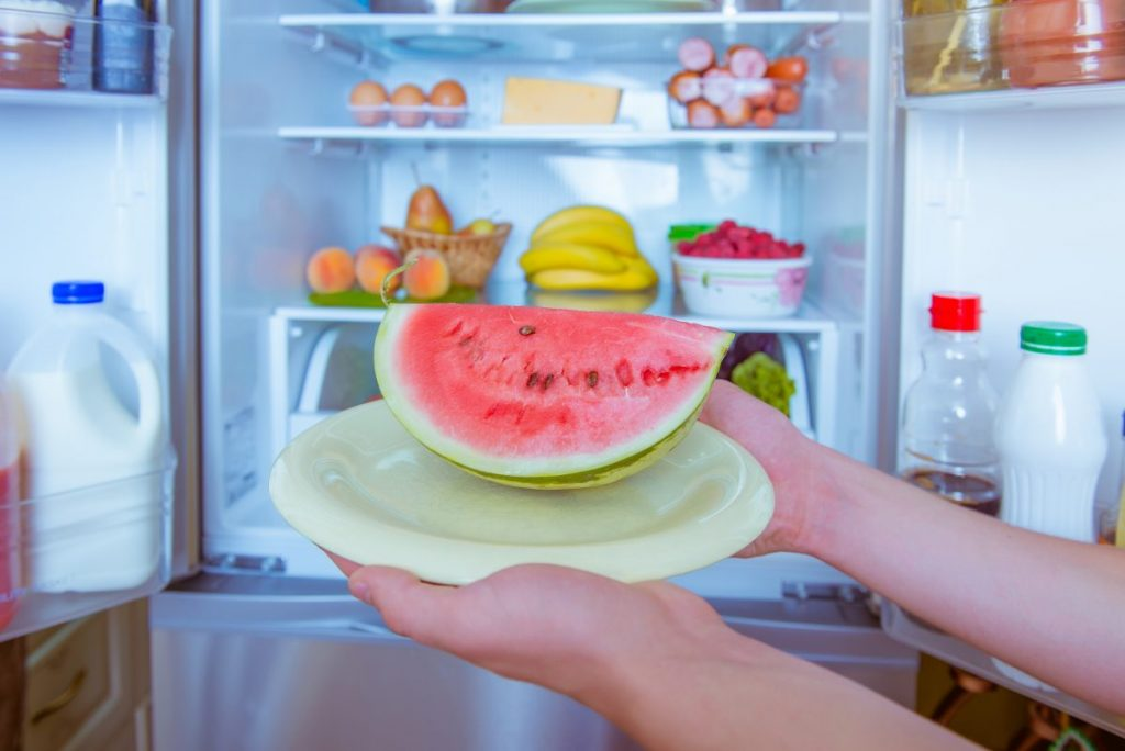 cut watermelon storing refrigerator