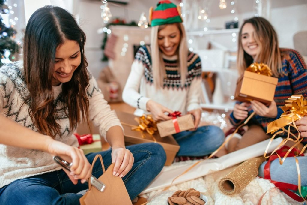 women wrapping gift
