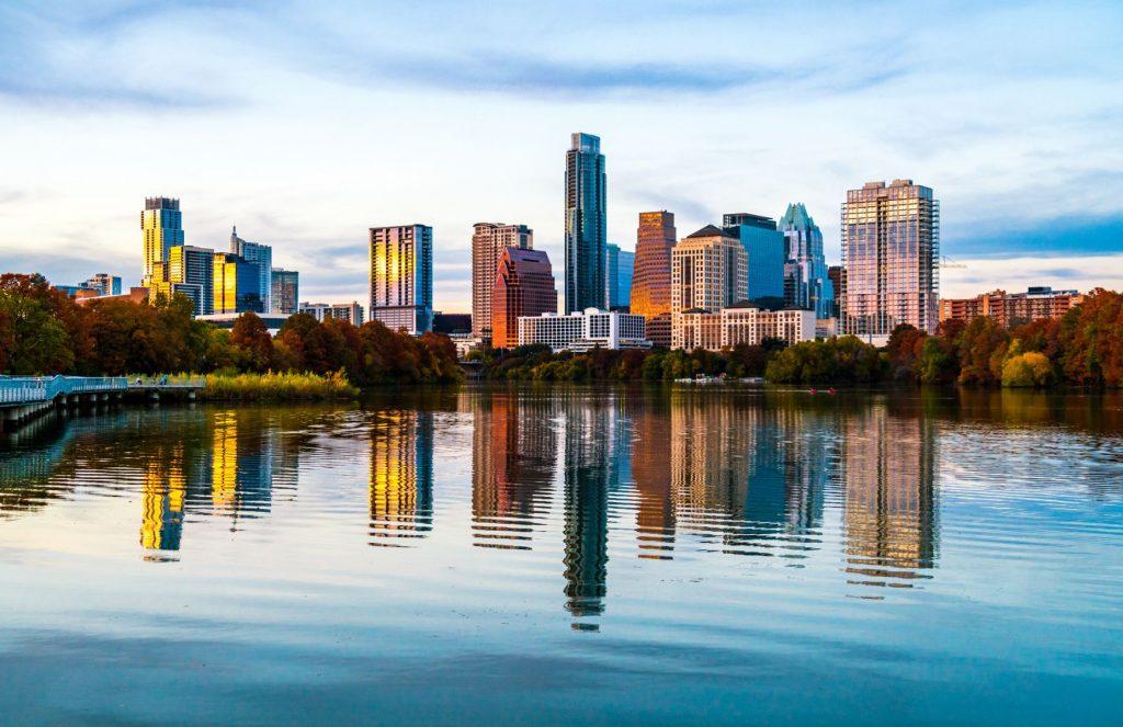 Lady Bird Lake mirrored skyline - Austin Texas