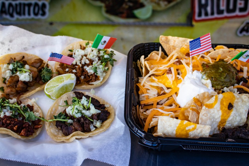 Traditional Carne Asada Tacos and Nachos with Mexican and American Mini Flags