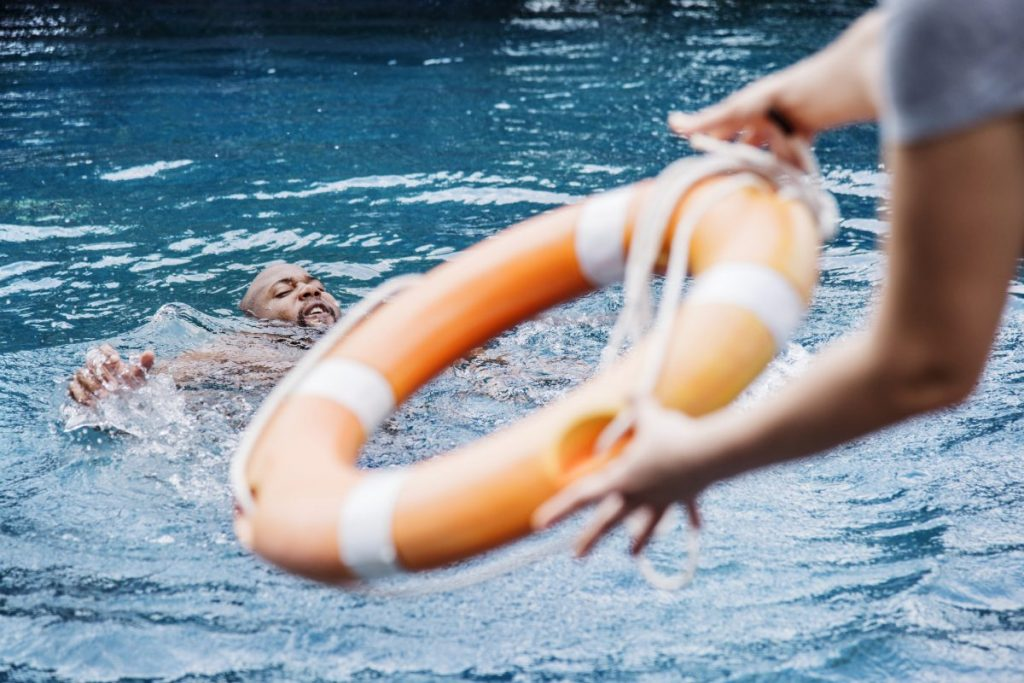 Swimmer being thrown life ring