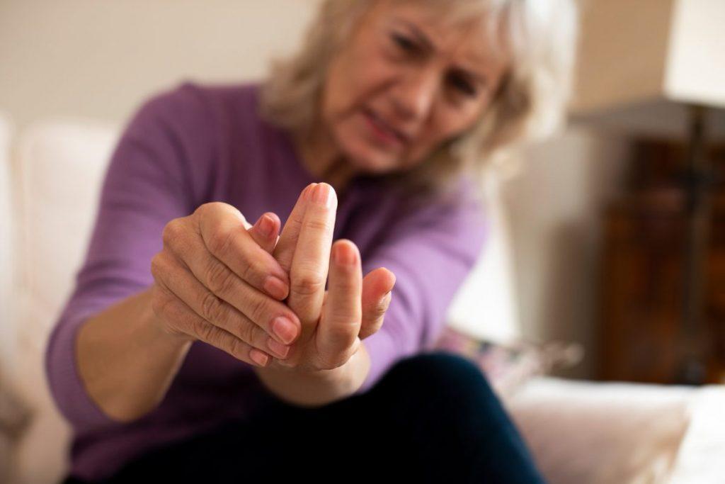 older women feeling her hands together