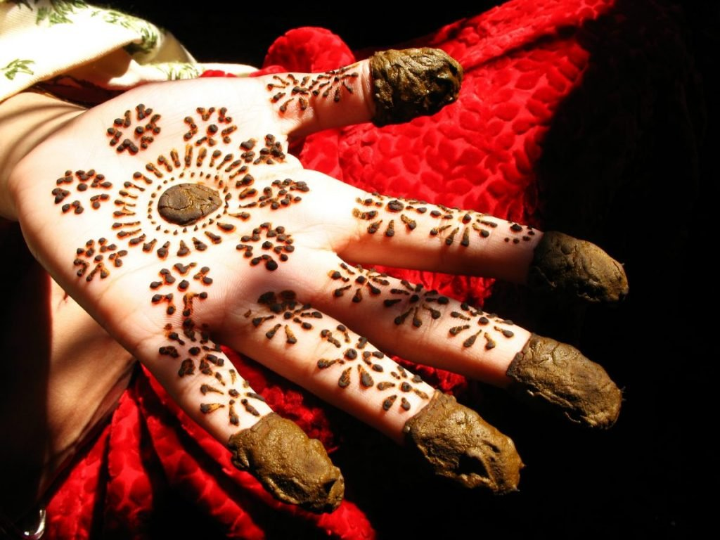 henna tattooed hands