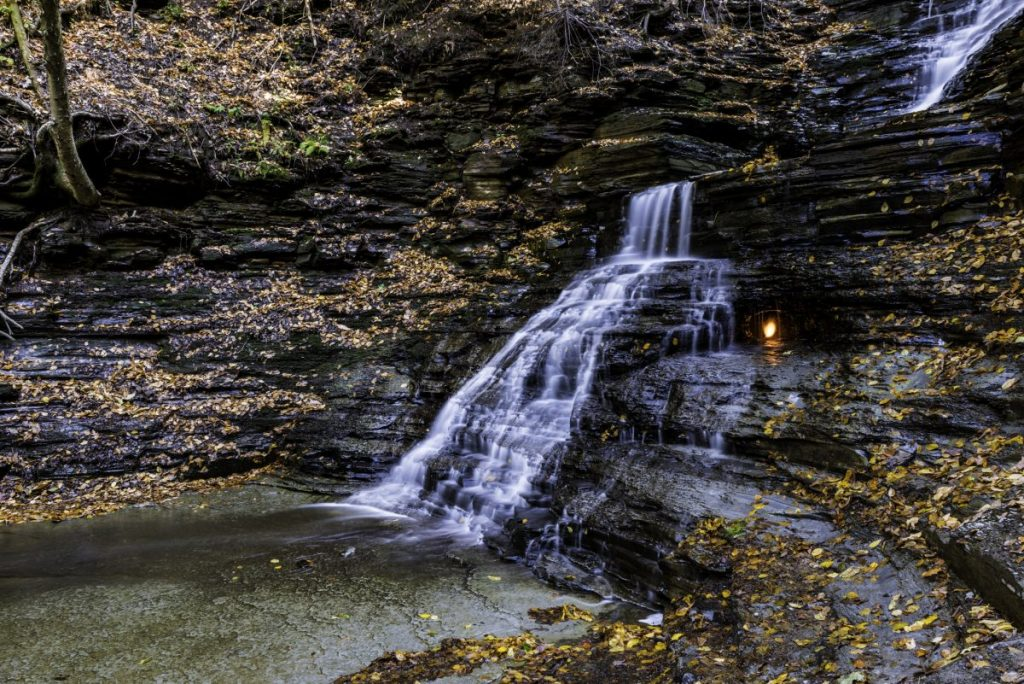 Eternal flame and waterfall