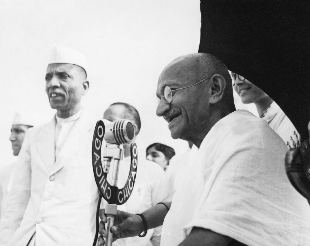 dian statesman and activist Mohandas Karamchand Gandhi (1869 - 1948) speaking into a microphone at Pune, 1944
