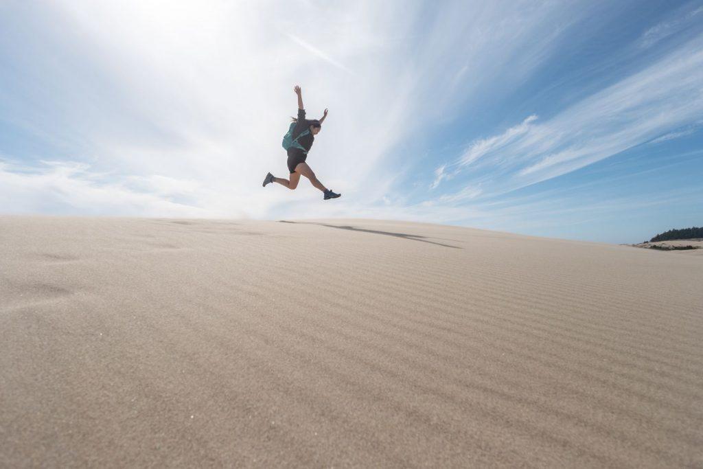 Millenial Woman at Oregon Dunes National Recreation Area, USA