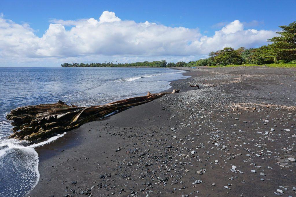 Black sand beach Tahiti island French Polynesia