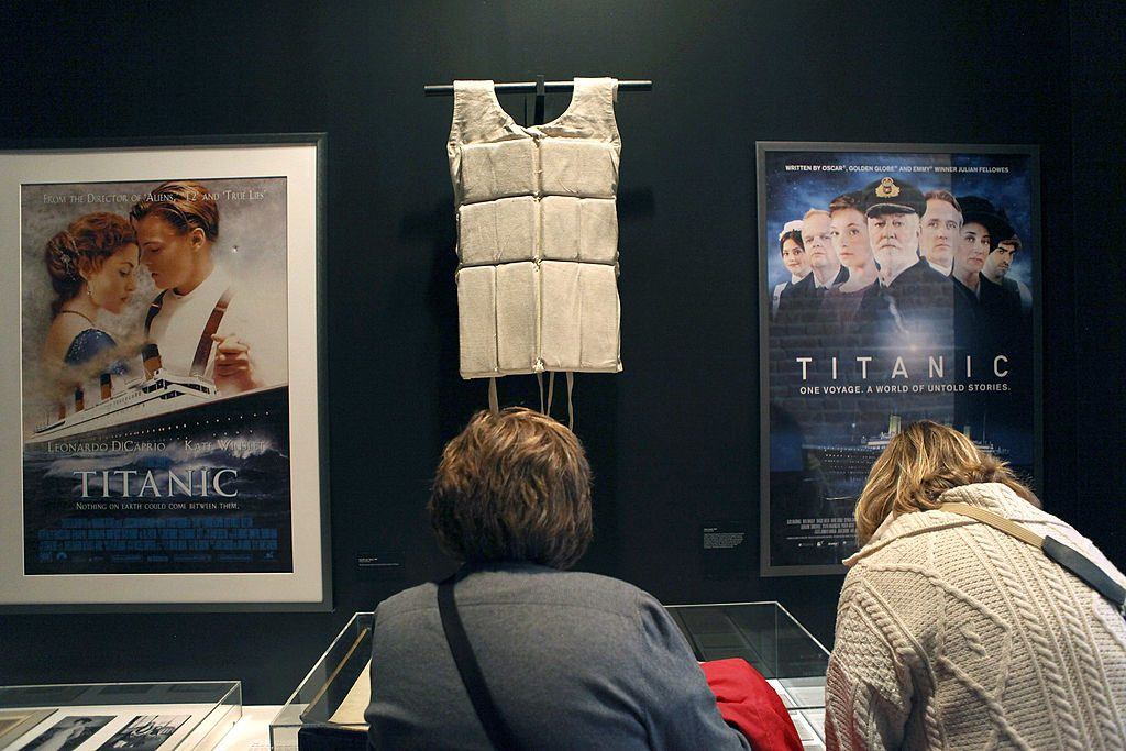 "A life vest and posters from the 1997 movie ""Titanic"" hang on display at the opening of the ""Titanic at 100: Myth and Memory"" exhibition on April 10, 2012 in New York City. The exhibit opened at the Melville Gallery, part of the South Street Seaport Museum, on the 100th anniversary of Titanic's launch on her maiden - and only - voyage. The exhibition features mayday communications from the ship, personal artifacts from survivors, production items from Titanic films and interactive multimedia tours through the ship. The British passenger liner sank in the North Atlantic Ocean, killing more than 1,500 people on April 15,1912 after colliding with an iceberg during her maiden voyage from Southampton, England to New York City."
