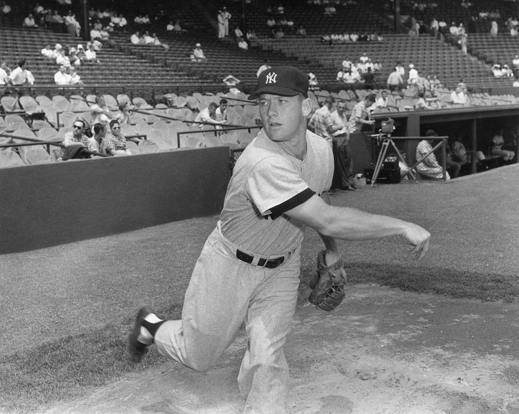 American baseball player Mickey Mantle (1931 - 1995), outfielder for the New York Yankees, throwing a ball at a game.