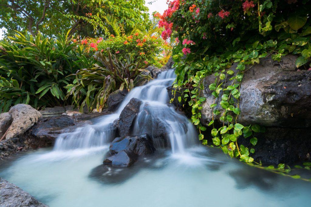 Waterfall at Waikiki Beach along Kalakaua Avenue in Honolulu, HI.