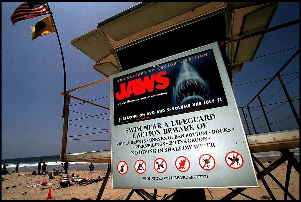 "A poster advertising the anniversary collector's edition of the movie ""Jaws"" is posted on a lifeguard tower June 2, 2000 on Zuma Beach in Malibu, CA. The sign has led to complaints by beach goers with young children, who feel that it is inappropriate for the sign to be on display so close to the water and so near the 4th of July."