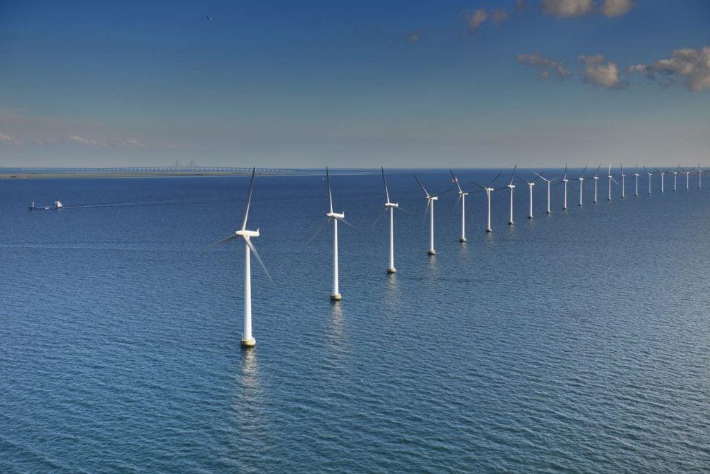 Middelgrunden Wind Turbine Offshore wind park and the Oresund Bridge in the background in Oresund outside Copenhagen, Denmark