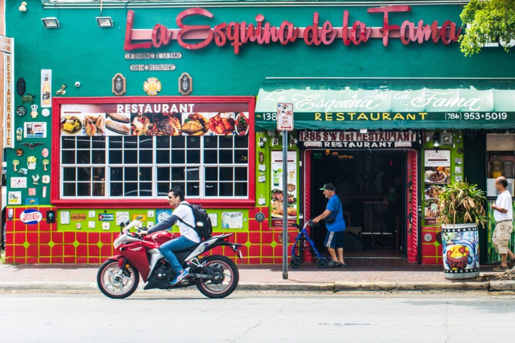 Miami - Scenes of daily life in Little Havana play out amidst a backdrop of pulsating traditional Cuban and Afro-Cuban music, storefronts, art galleries and quaint restaurants