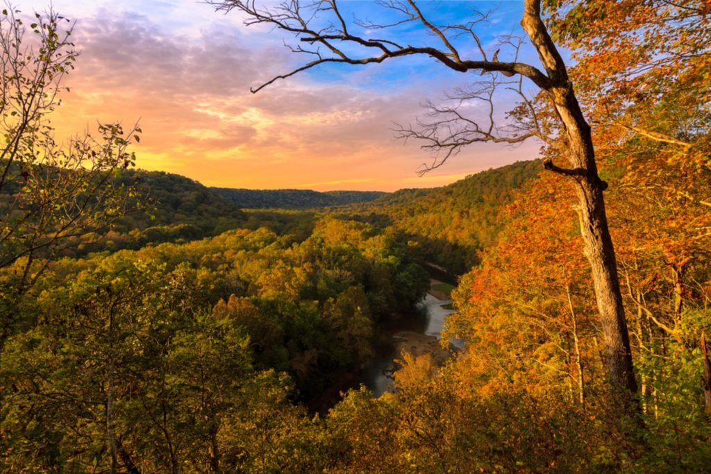 The sun sets over the Green River