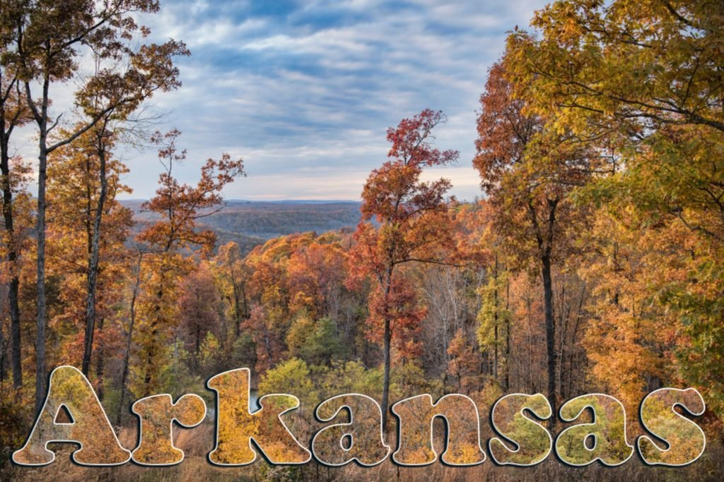 Ponca City Arkansas Fall Scene with the Word Arkansas Filled with Autumn Foliage in Foreground