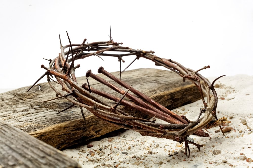 Jesus Crown Thorns and nails and cross on sand