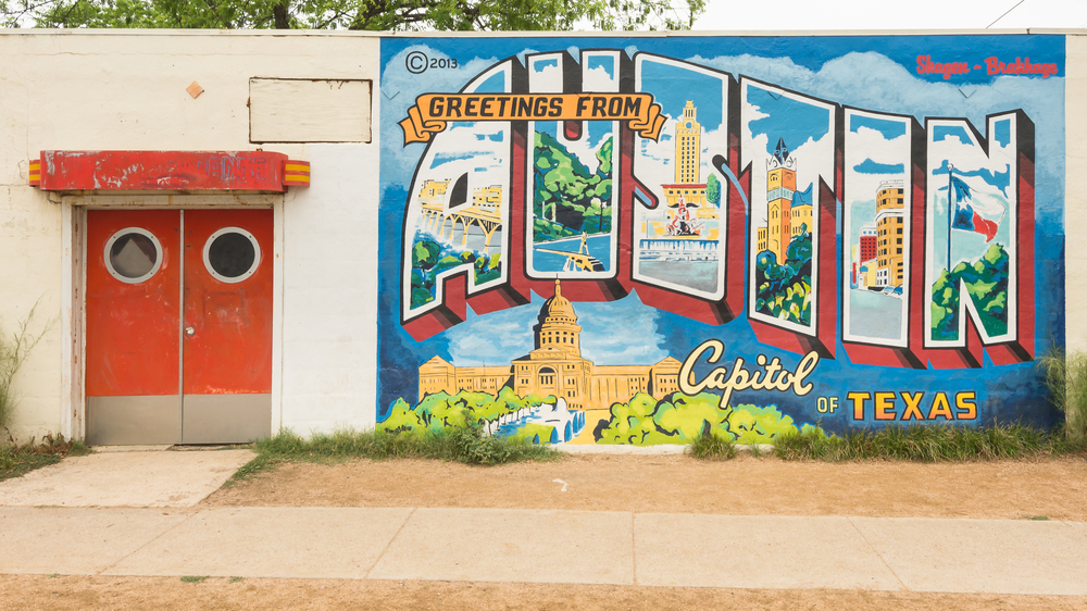 """Greetings From Austin - Capitol of Texas"""" postcard mural, Roadhouse Relics building. Landmarks: Congress Avenue"""