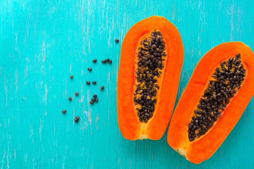 Papaya fruit on wooden background