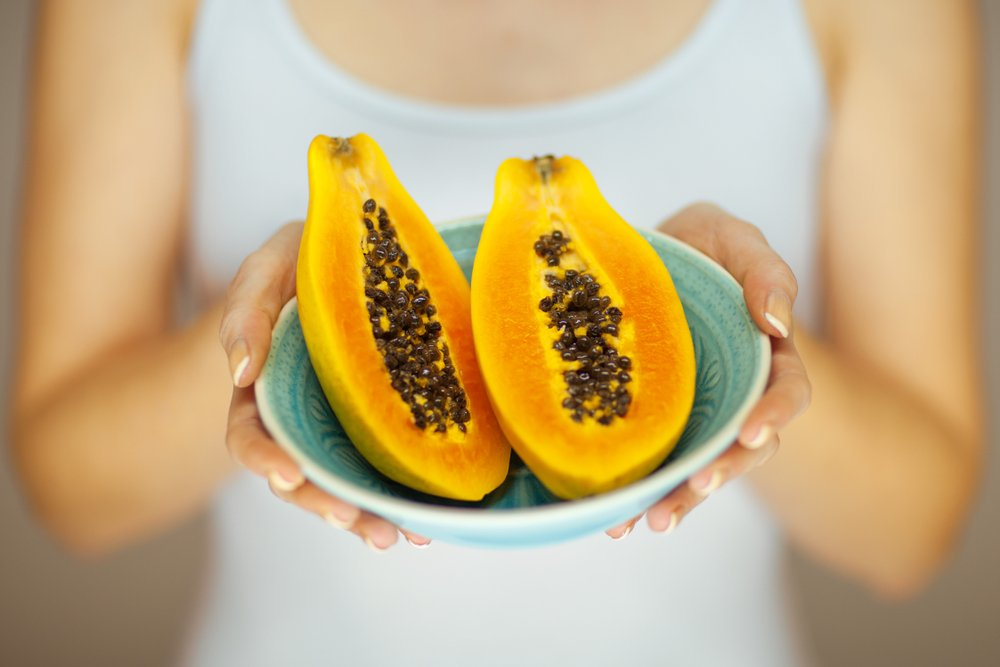 woman hands holding some papayas