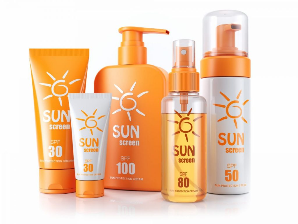 Multiple sunblock and oil bottles