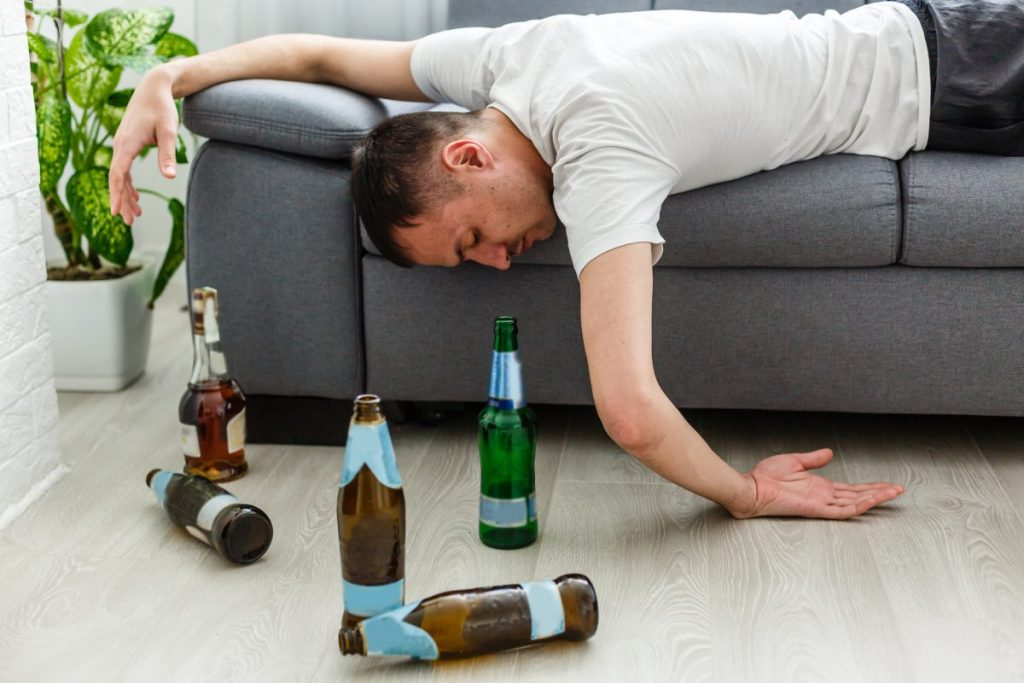 Man passed out amid alcohol bottles