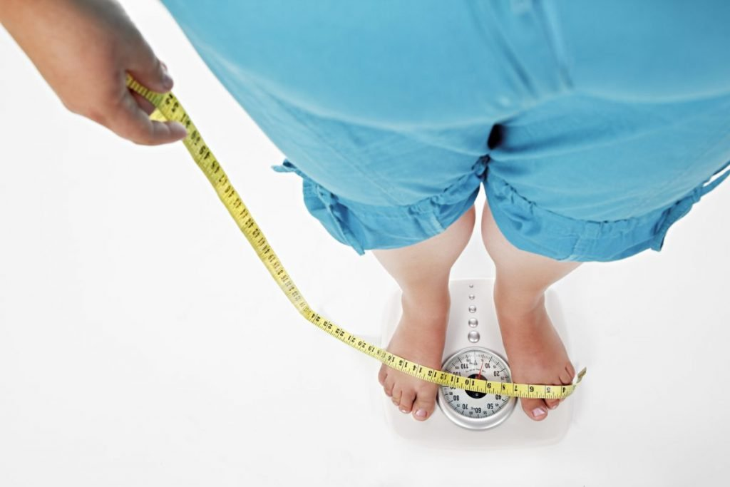 woman weight scale measuring tape