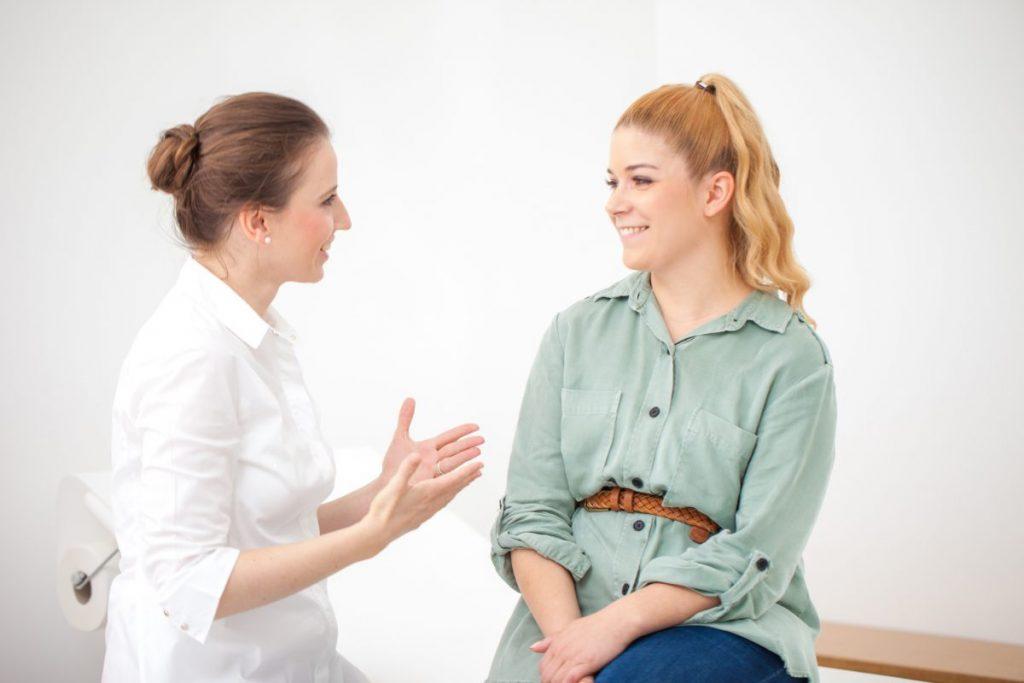 Dermatologist talking to patient