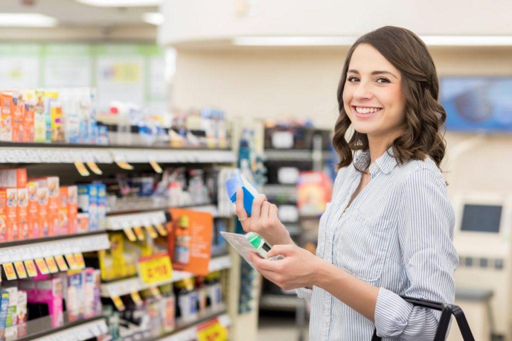 Smiling woman buying medication