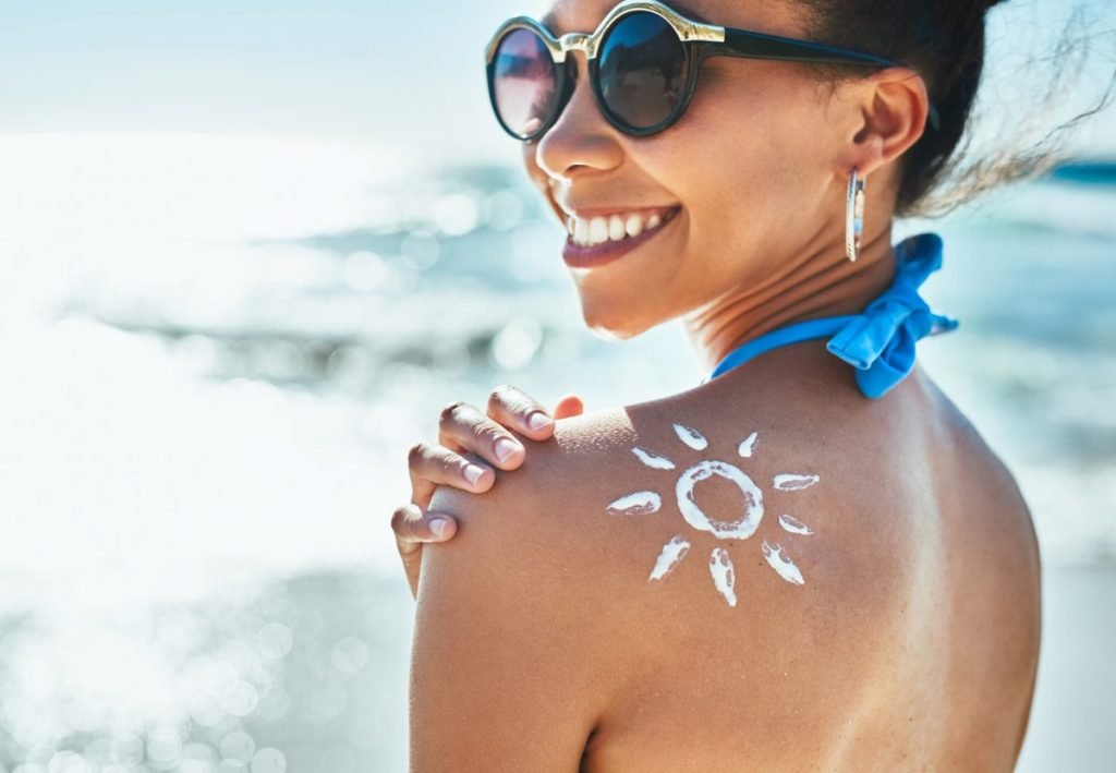 Woman smiling with sunscreen sun
