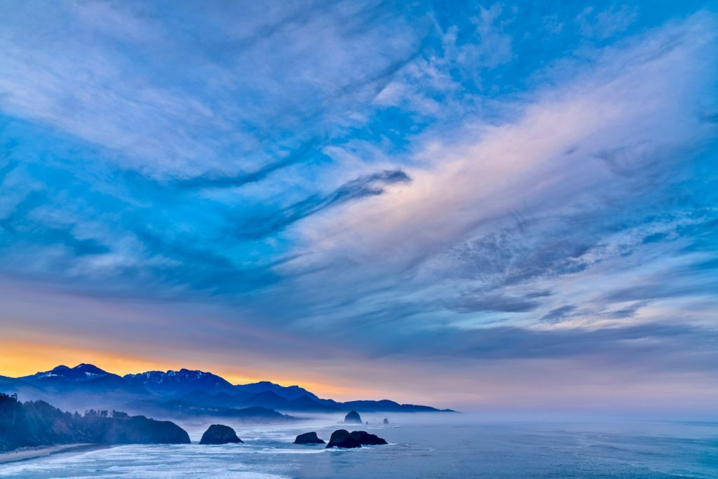Sunrise on Sea stack formations off the town of Cannon Beach on the Oregon Coast