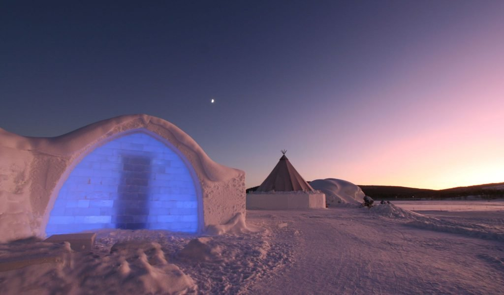 Entrance to Ice hotel with Arctic Sunset