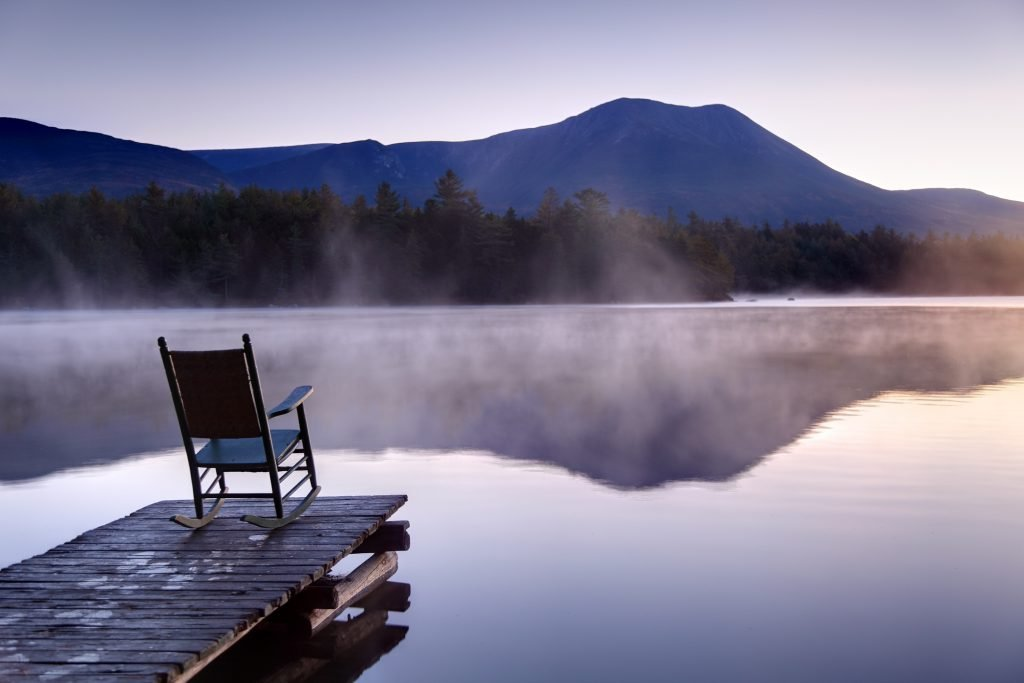 Beautiful view of a calm Lake with Boardwalk in Baxter State Park located in Maine. Photo taken during a serene tranquil morning during the autumn foliage season. Maine fall foliage ranks with the best in New England bringing out some of the most beautiful foliage in the United States