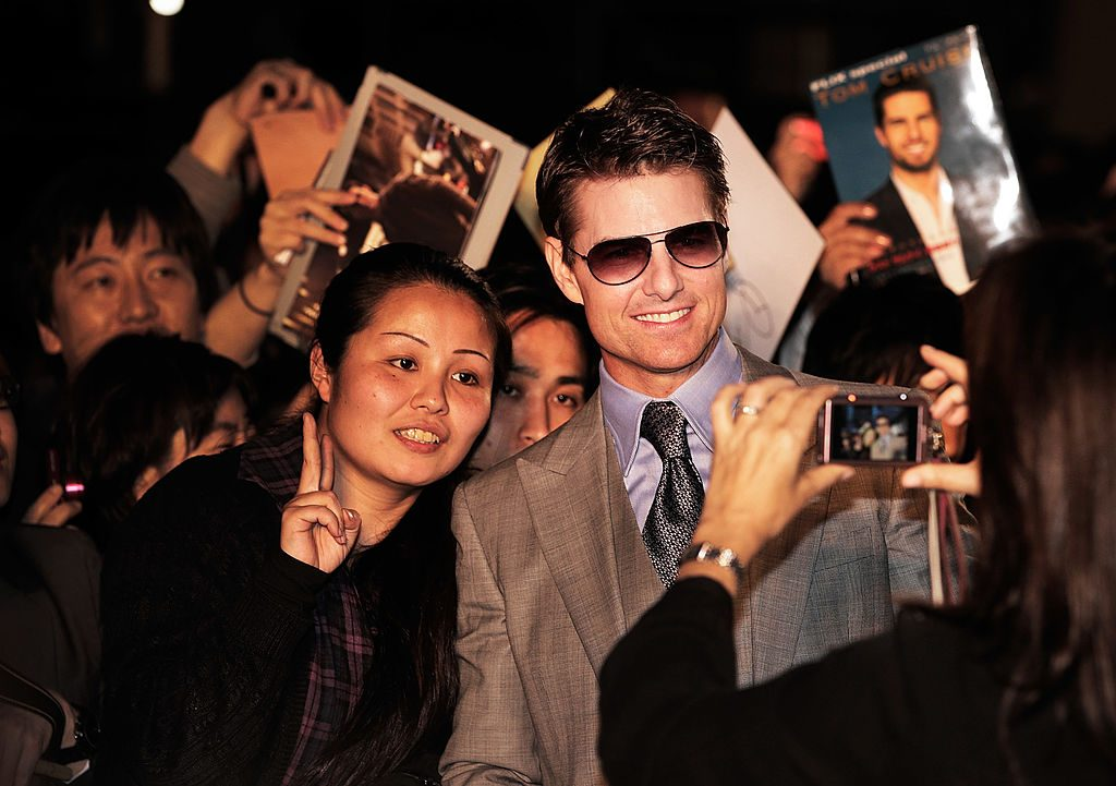 Tom Cruise poses for photographs and signs autographs while attending the 'Oblivion' Japan Premiere at Roppongi Hills on May 8, 2013 in Tokyo, Japan. The film will open on May 31 in Japan.
