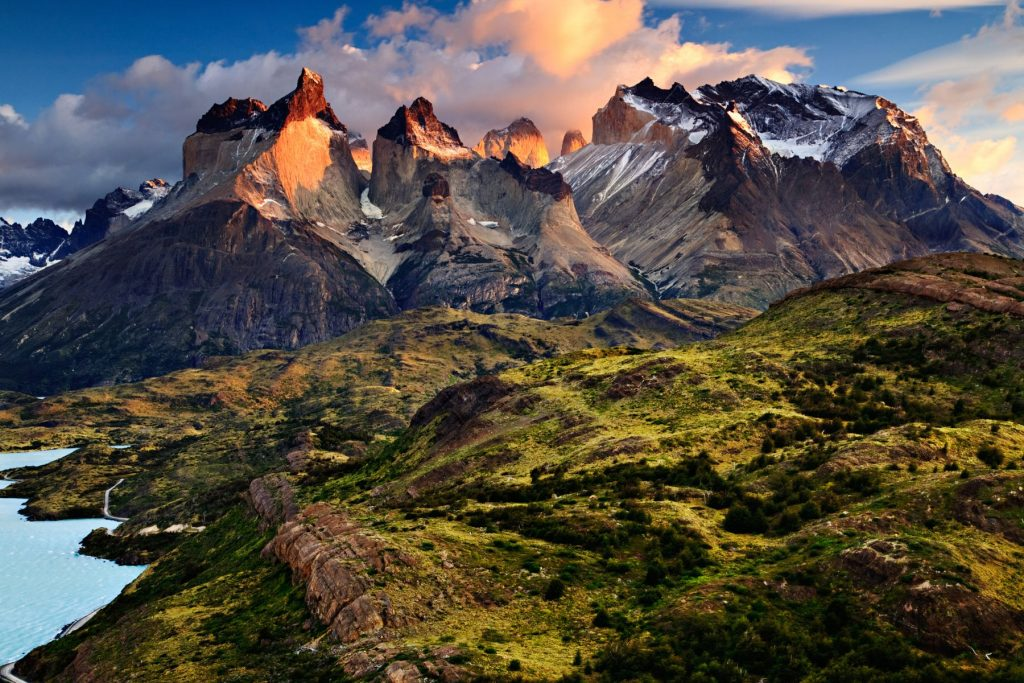 """An early morning sunrise landscape photograph of the Cuernos del Paine, or """"Horns of Paine"""", a world-famous mountain range in Patagonia and the Andes."""