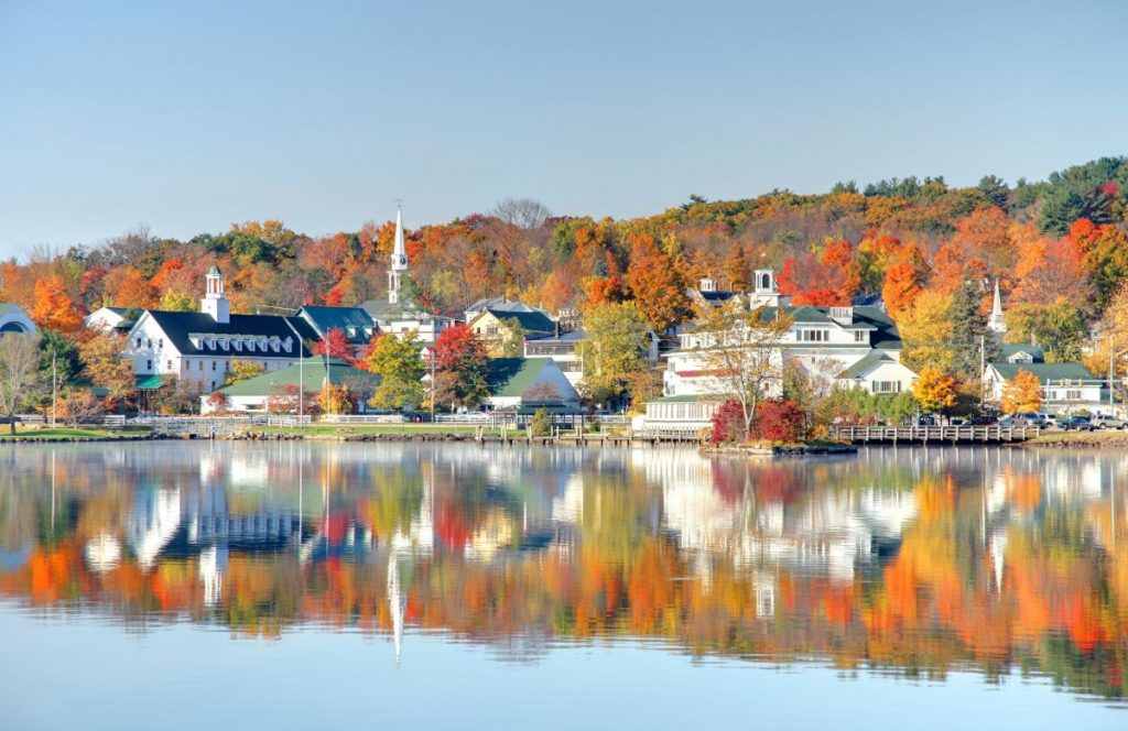 Autumn foliage reflection along the shores of Lake Winnipesaukee in Meredith, New Hampshire.
