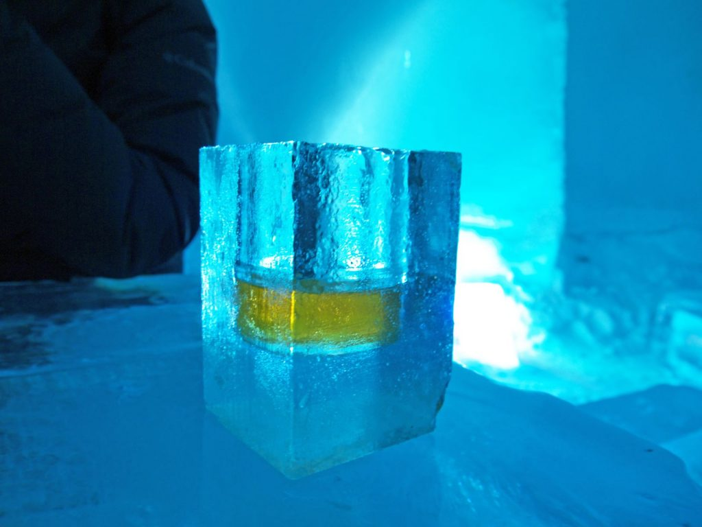 Frozen Shot glass with whiskey made of ice