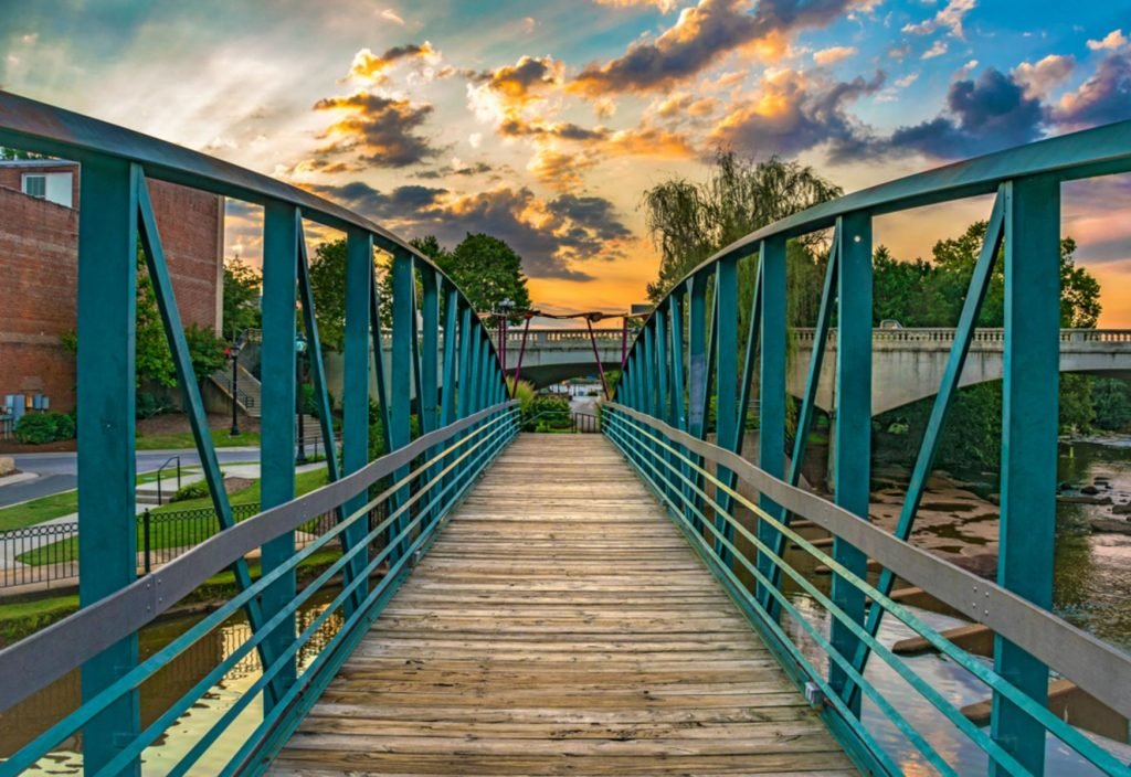 RiverPlace Bridge at sunrise on Main Street in Downtown Greenville South Carolina