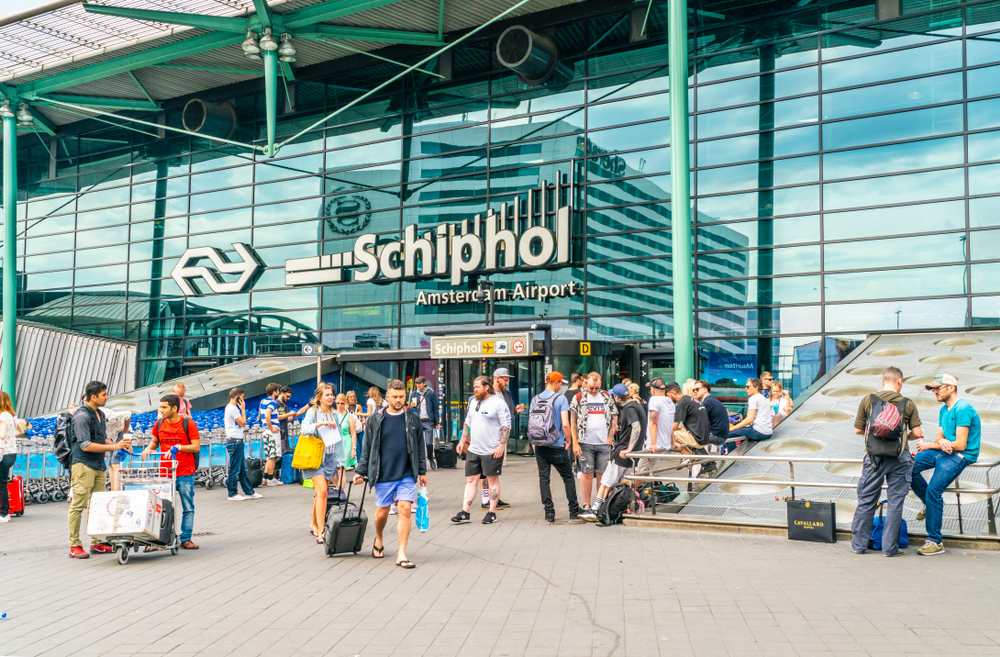 Passengers entering and leaving the main building at Schiphol airport in Amsterdam