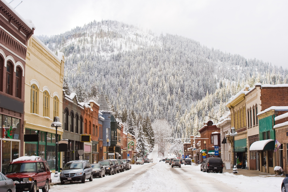Winter in Downtown Wallace Idaho with snow and mountain in background