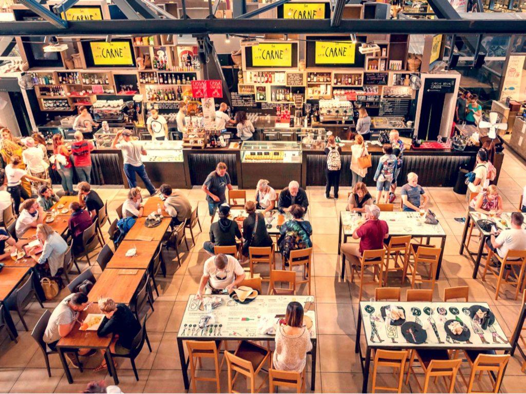 People having breakfast at popular food court inside Mercato Centrale city market