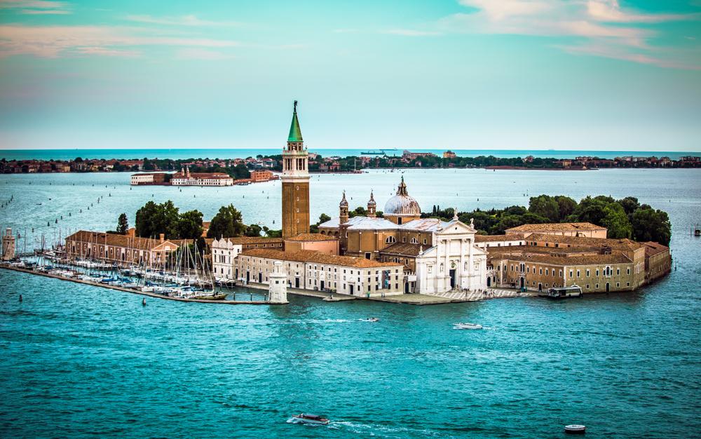 Aerial view of the Venice city scape with Basilica Di San Giorgio Maggiore and grande canal