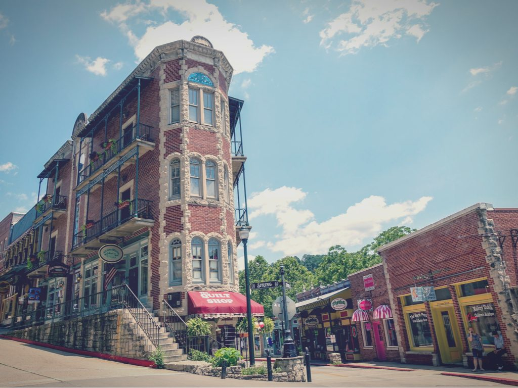 Tourists look at the flatiron building in Eureka Springs