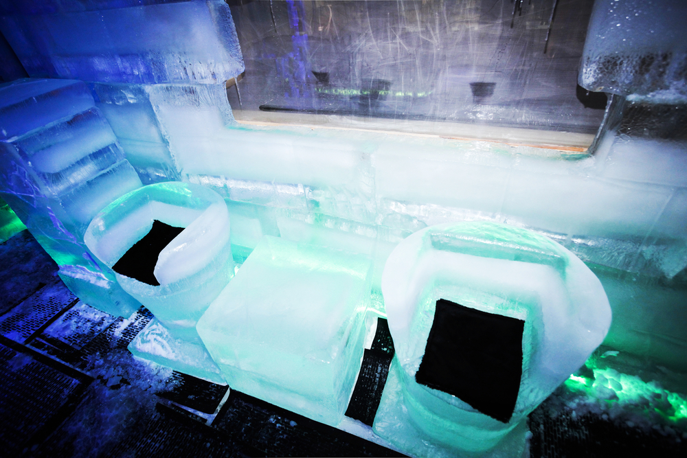 Ice chairs in pop up ice bar