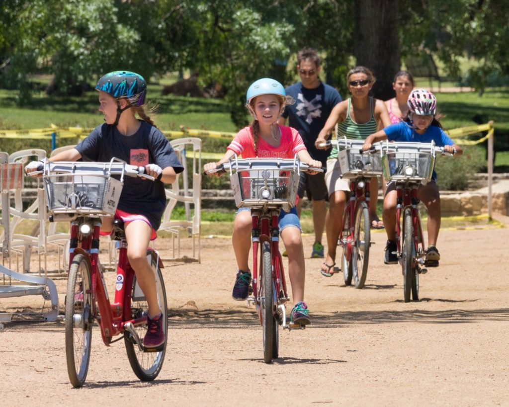 a group of children on bikes in the park