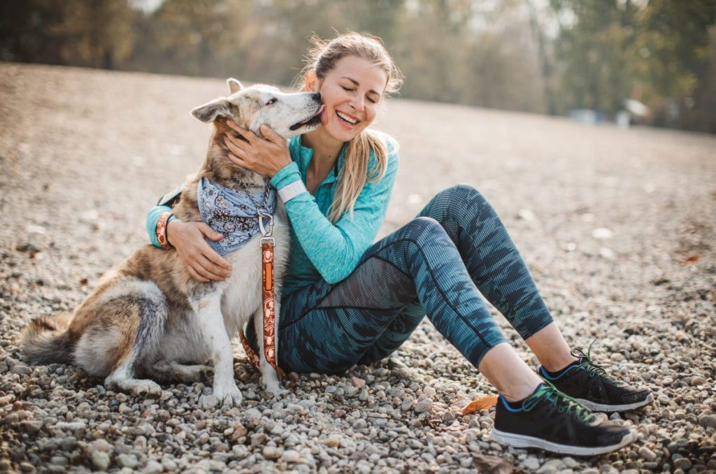 Happy woman with healthy dog